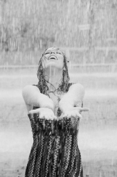 black-and-white-image-of-woman-standing-in-the-rain